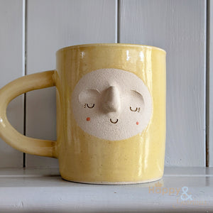 Hand thrown buttercup yellow stoneware face mug