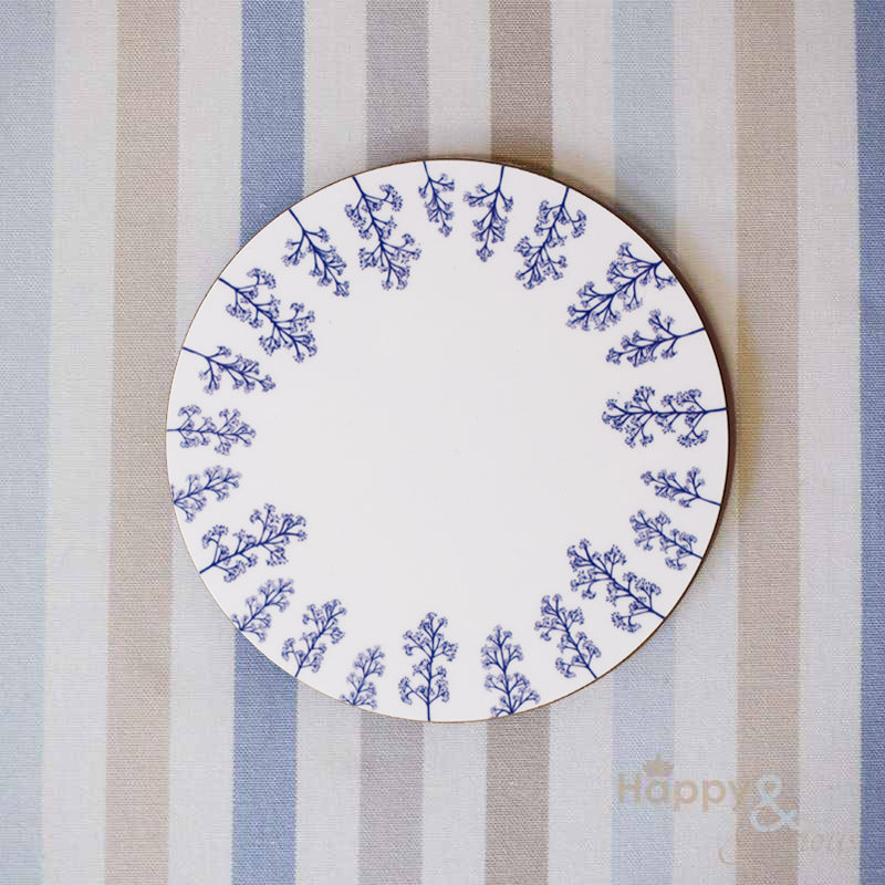 Navy blue & white skimmia silhouette wooden coaster by Kate Tompsett