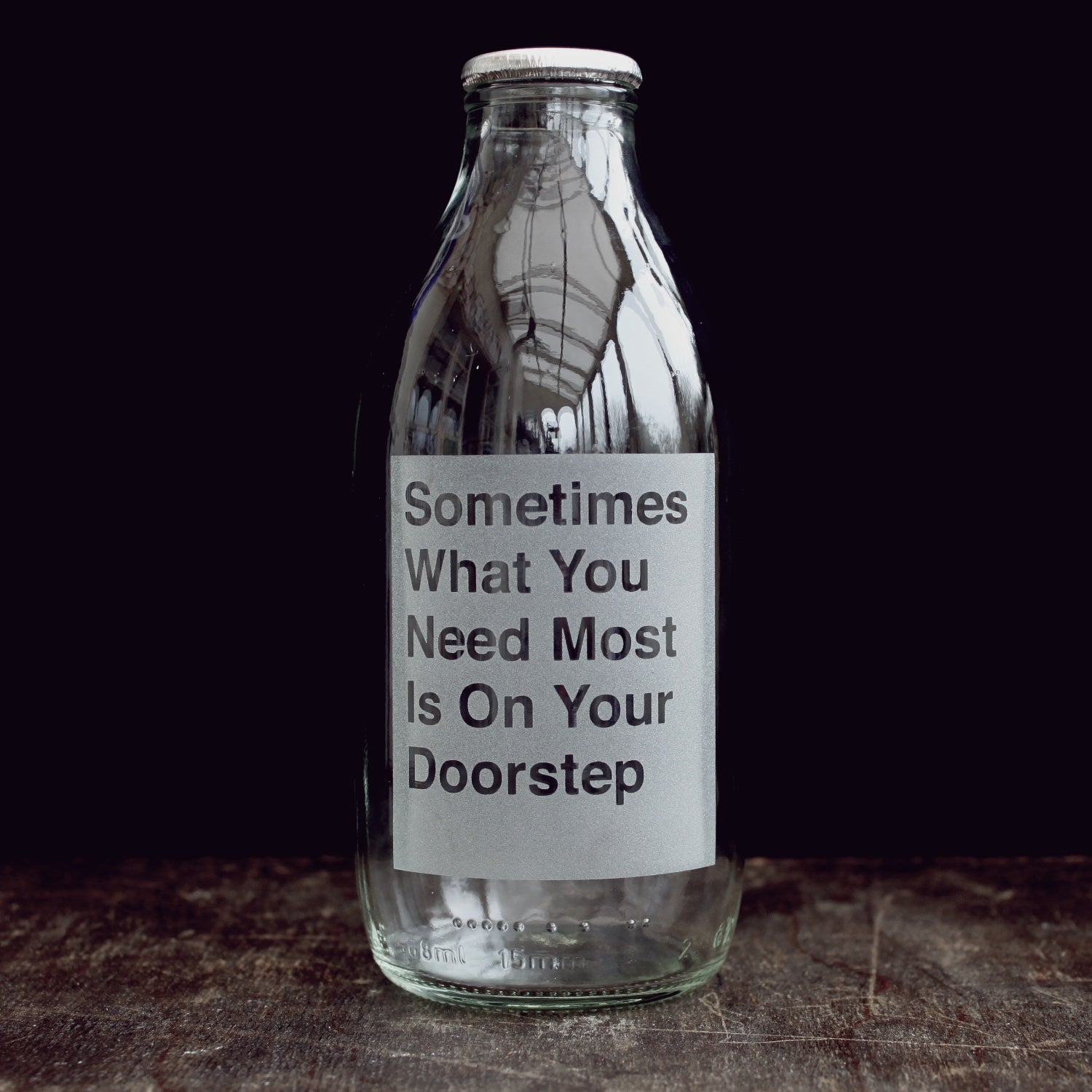 'On your Doorstep' etched glass milk bottle