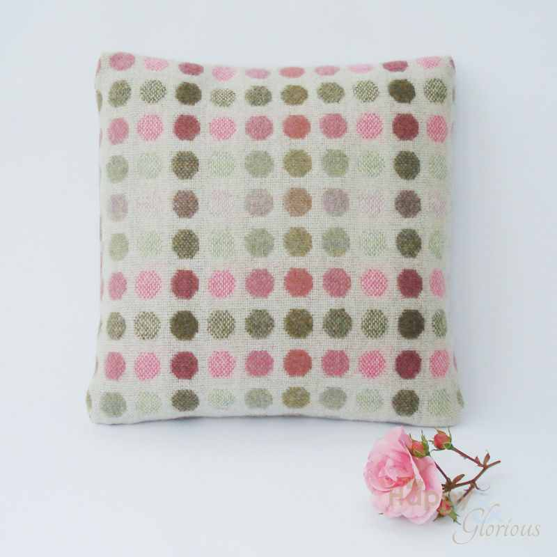 Rose pink 'Mondo' spot pure lambswool cushion by Melin Tregwynt