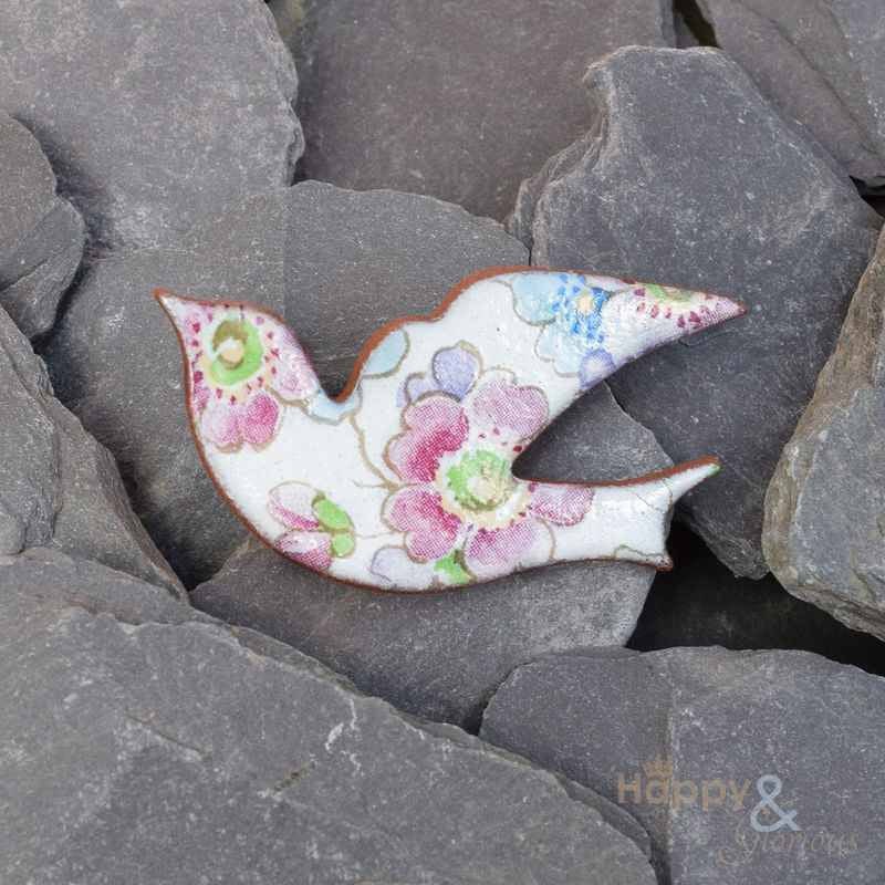 White, pink and blue floral ceramic bird brooch by Stockwell Ceramics