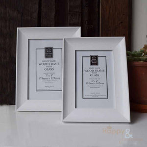 Soft white wooden photograph frame
