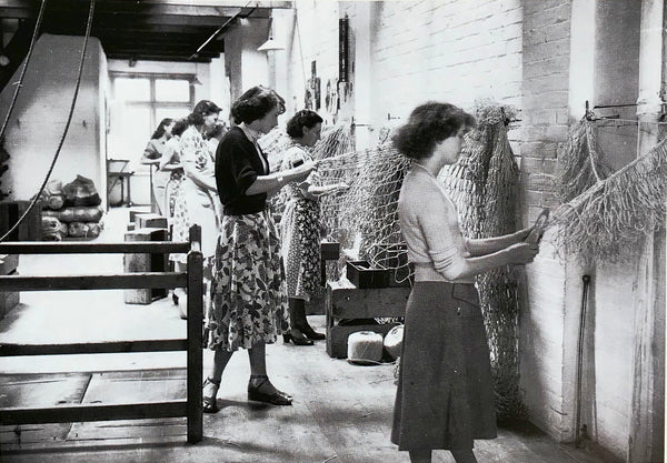 Women braiding fishing nets inside the ground floor of The Old Net Works, Whapload Road, Lowestoft