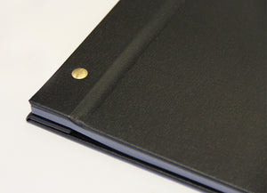 Close up of photo album showing bronze screws