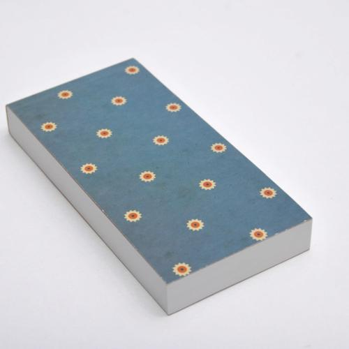 Notebook with perforated sheets and blue pattern cover