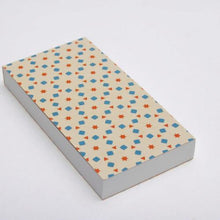 Notebook with perforated sheets and cream pattern cover