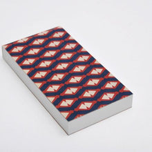 Notebook with perforated sheets and red blue pattern cover
