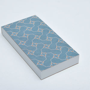 Notepad with perforated sheets and blue pattern cover