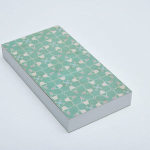 Notepad with perforated sheets and green pattern cover