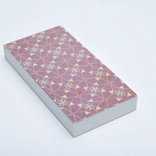 Notepad with perforated sheets and purple pattern cover