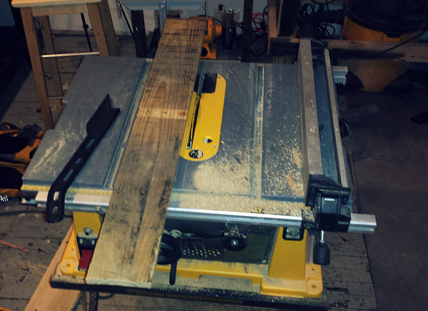 Rip pallet board with table saw