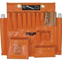The Klein 51829M Large Orange Vinyl Aerial Apron with Magnet makes it easy for utility workers, electricians and other tradespeople to conveniently carry tools and equipment from jobsite to jobsite.