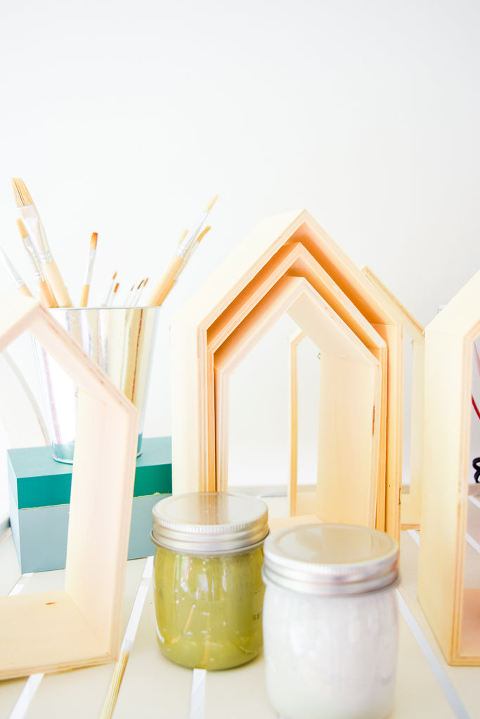 Create a oneof-a-kind rainbow shelf system for your little one's nursery or playroom decor, using Homestead House Milk Paint and custom mixed colors.