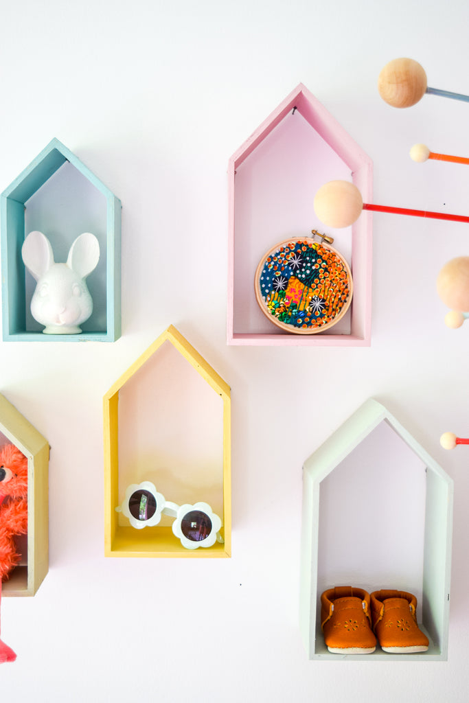 Create a one of-a-kind rainbow shelf system for your little one's nursery or playroom decor, using Homestead House Milk Paint and custom mixed colors.