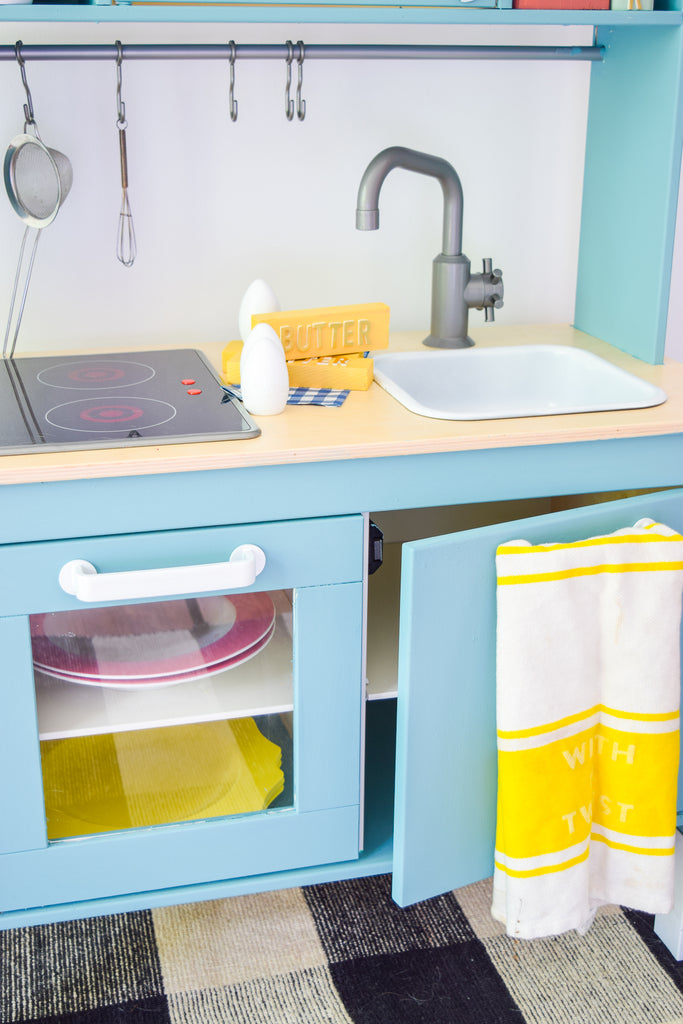 Give the IKEA DUKTIG Play Kitchen a makeover with NO VOC milk paint.