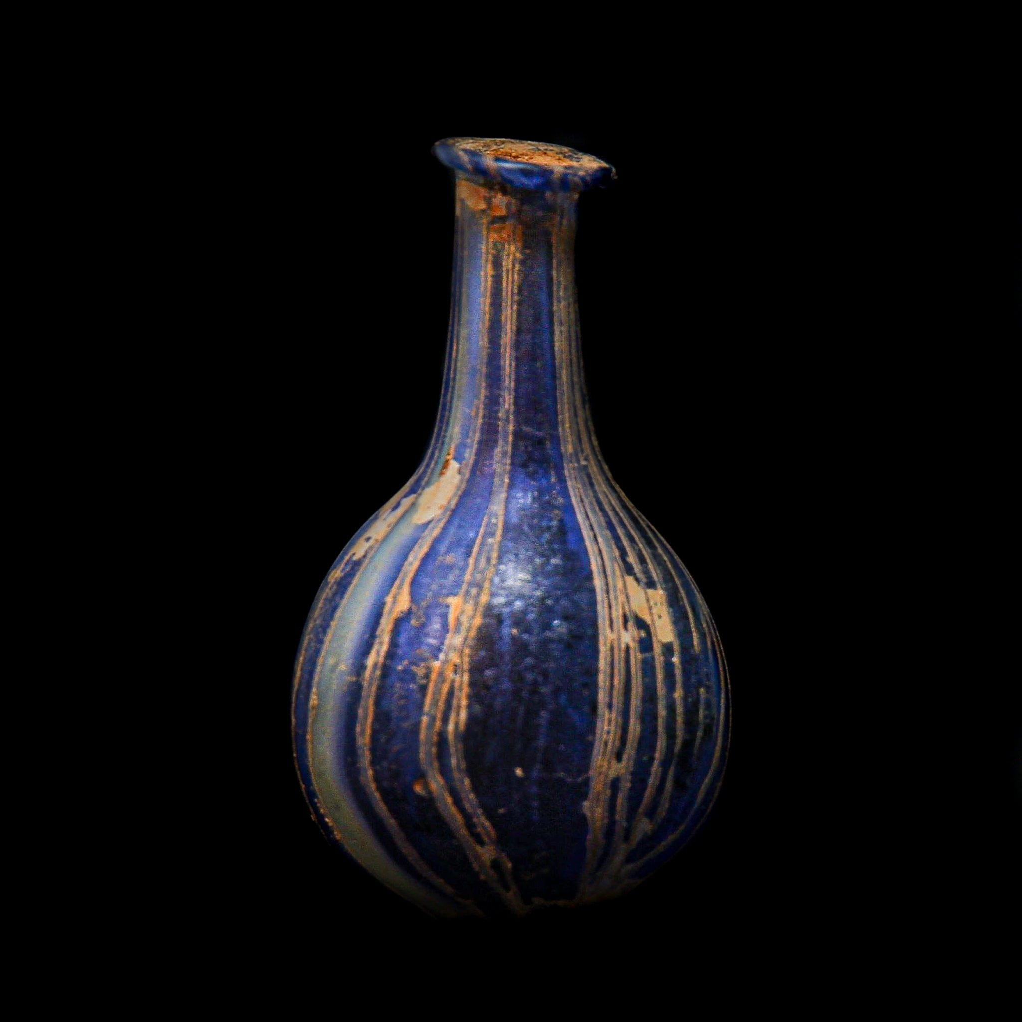 A Roman Blue Marbled Glass Vessel | 2nd-3rd century AD