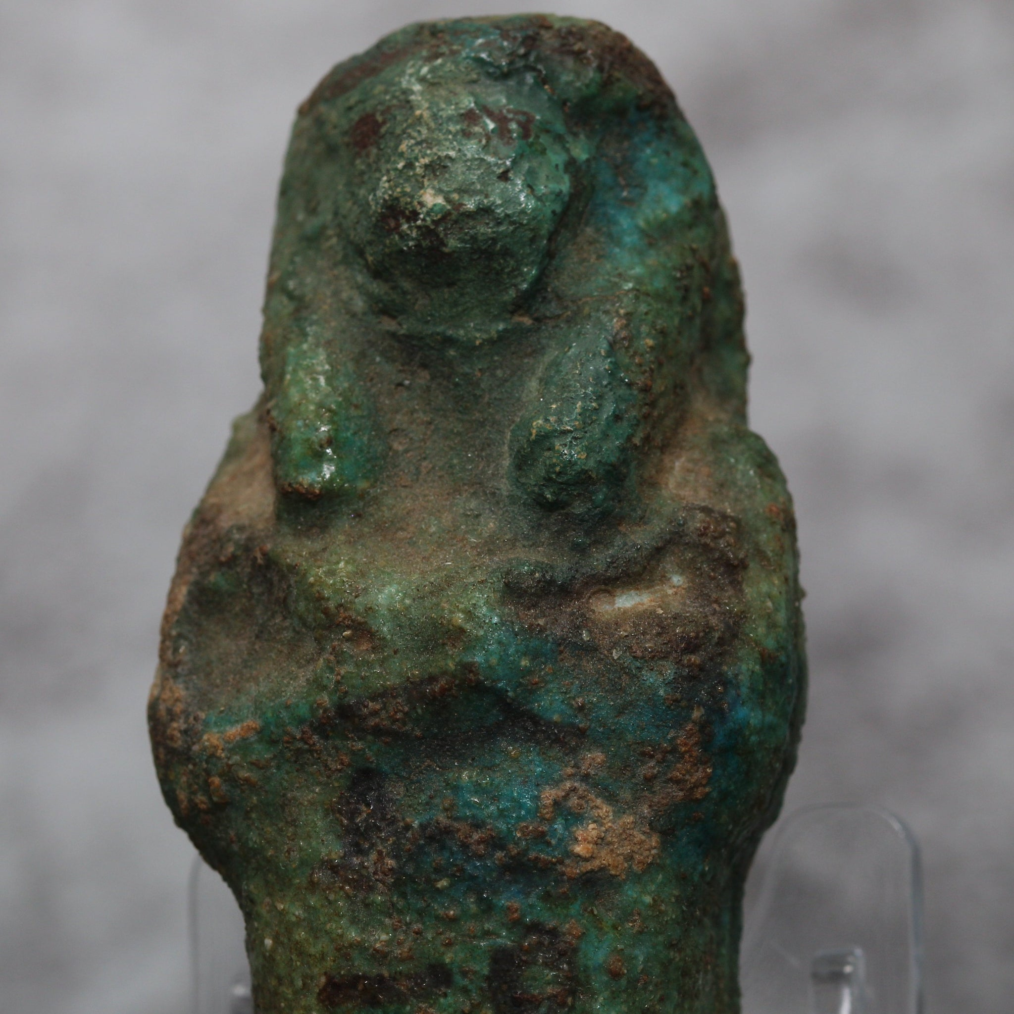 "A green glazed faience shabti figure with inscription ""the Osiris Ankh-es-(-en) Amen"" 