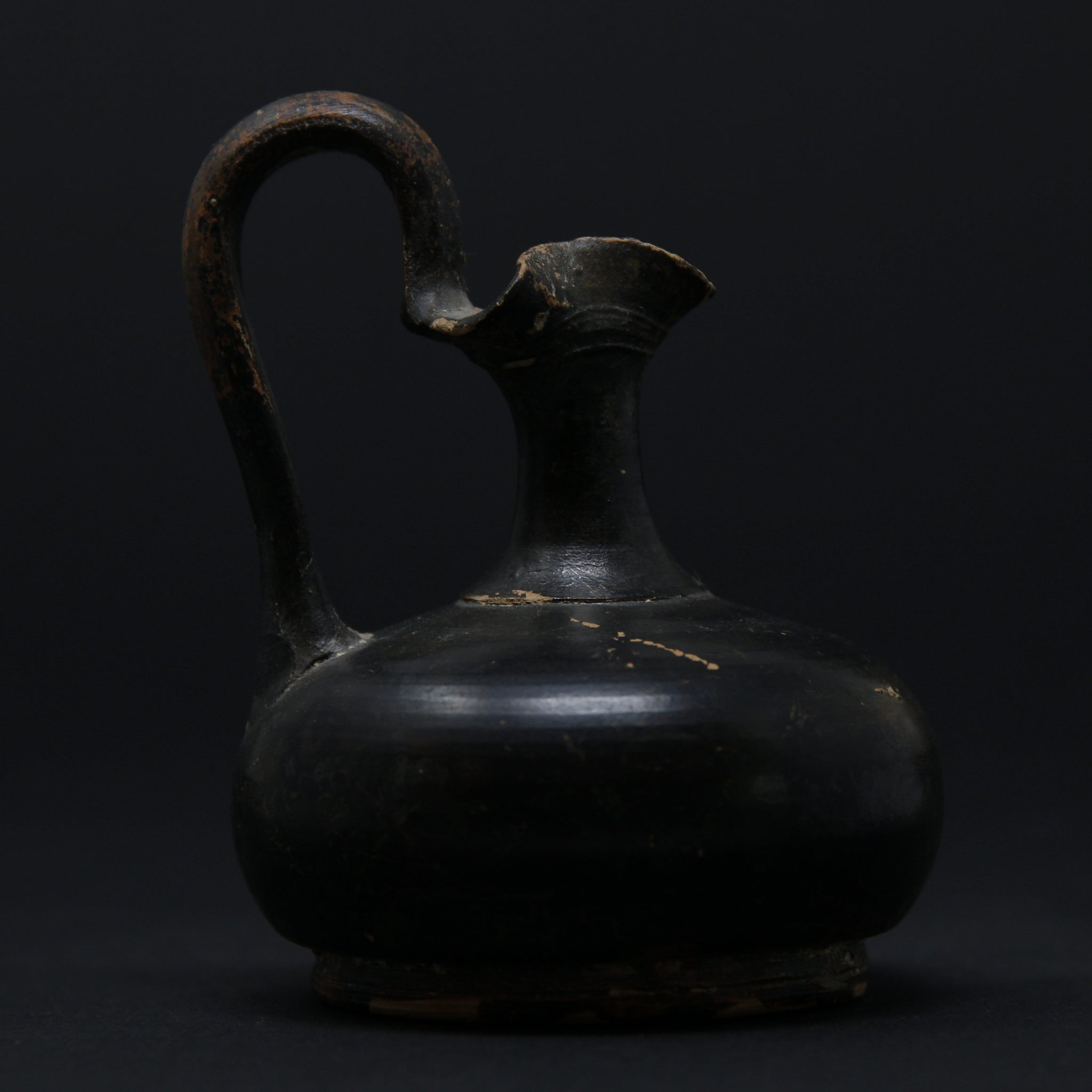 A Greek pottery black glazed jug | Greek, 4th Century BC