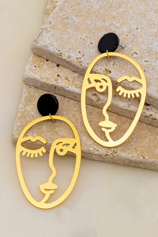 Winky Face Cutout Earrings.