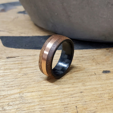 A custom wood ring with a gold inlay