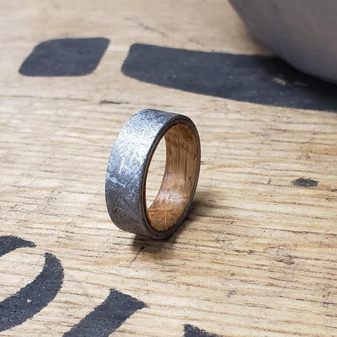A custom wood and meteorite ring