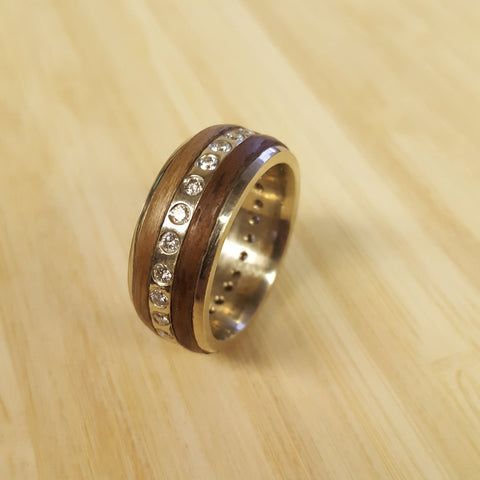 A white gold and diamond band with wood inlay