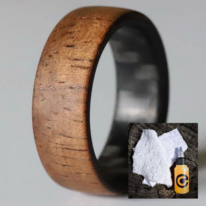 Koa wood wedding ring with wood ring care kit