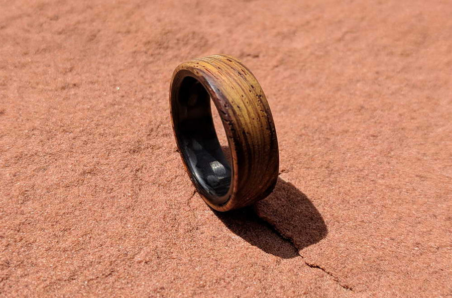 A cocobolo wood ring on the red rocks