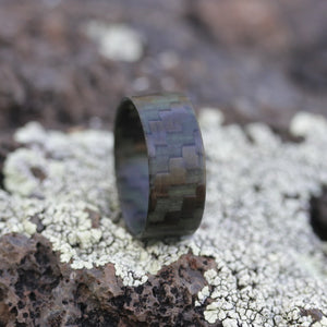 Glowing carbon fiber ring on a rock