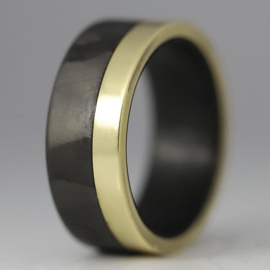 A gold and carbon fiber ring