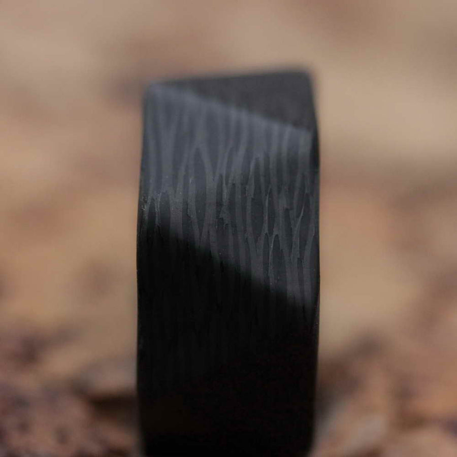 A Facet Wave Carbon Fiber Ring viewed straight on