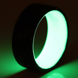A glowing green carbon fiber ring