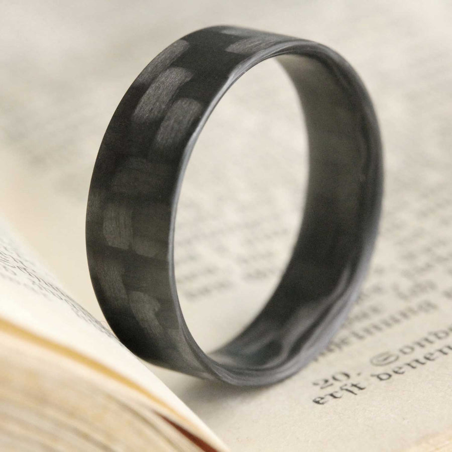 Carbon Fiber Ring in a book