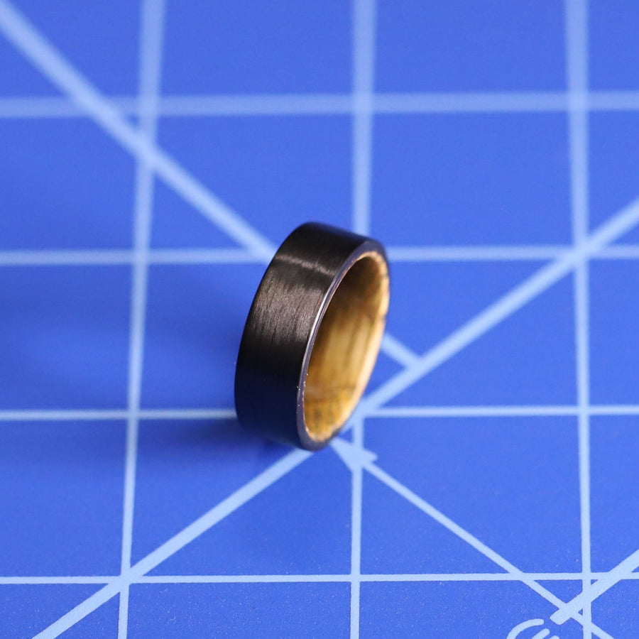A whiskey barrel and carbon fiber wood ring