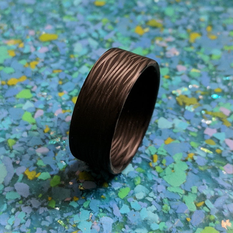 A carbon fiber men's wedding ring