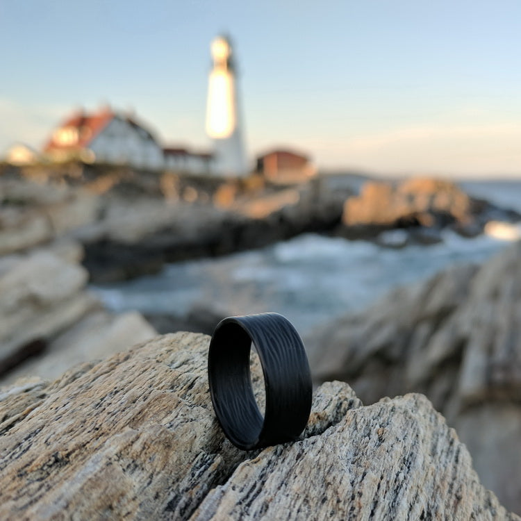 A carbon fiber ring on the seaside