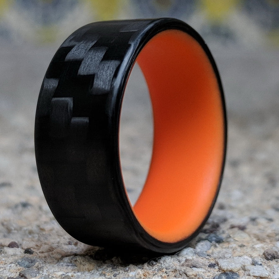 A glowing carbon fiber ring with orange glow