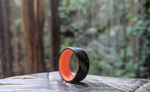 A glowing carbon fiber ring outside