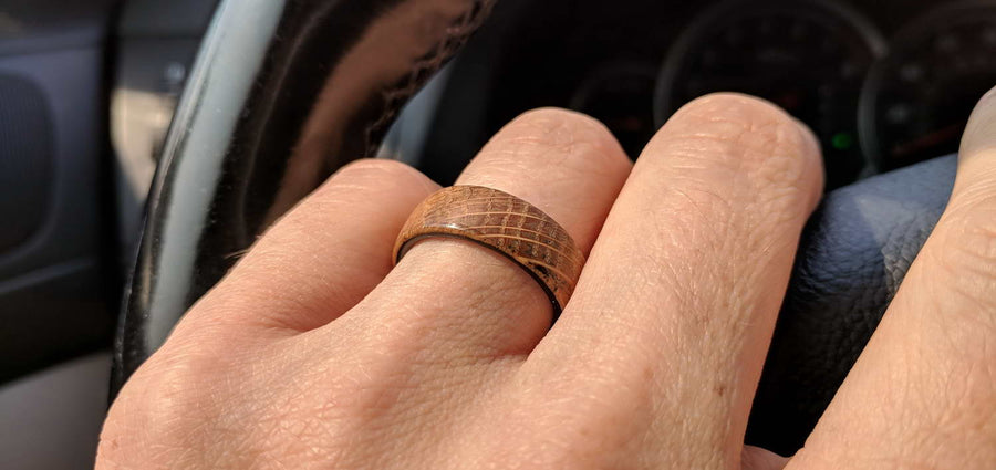 Whiskey Barrel wood ring on a hand