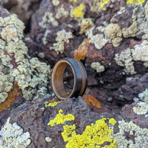 Whiskey barrel wood wedding ring with carbon fiber