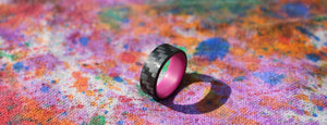 A purple carbon fiber glow ring on a colorful canvas