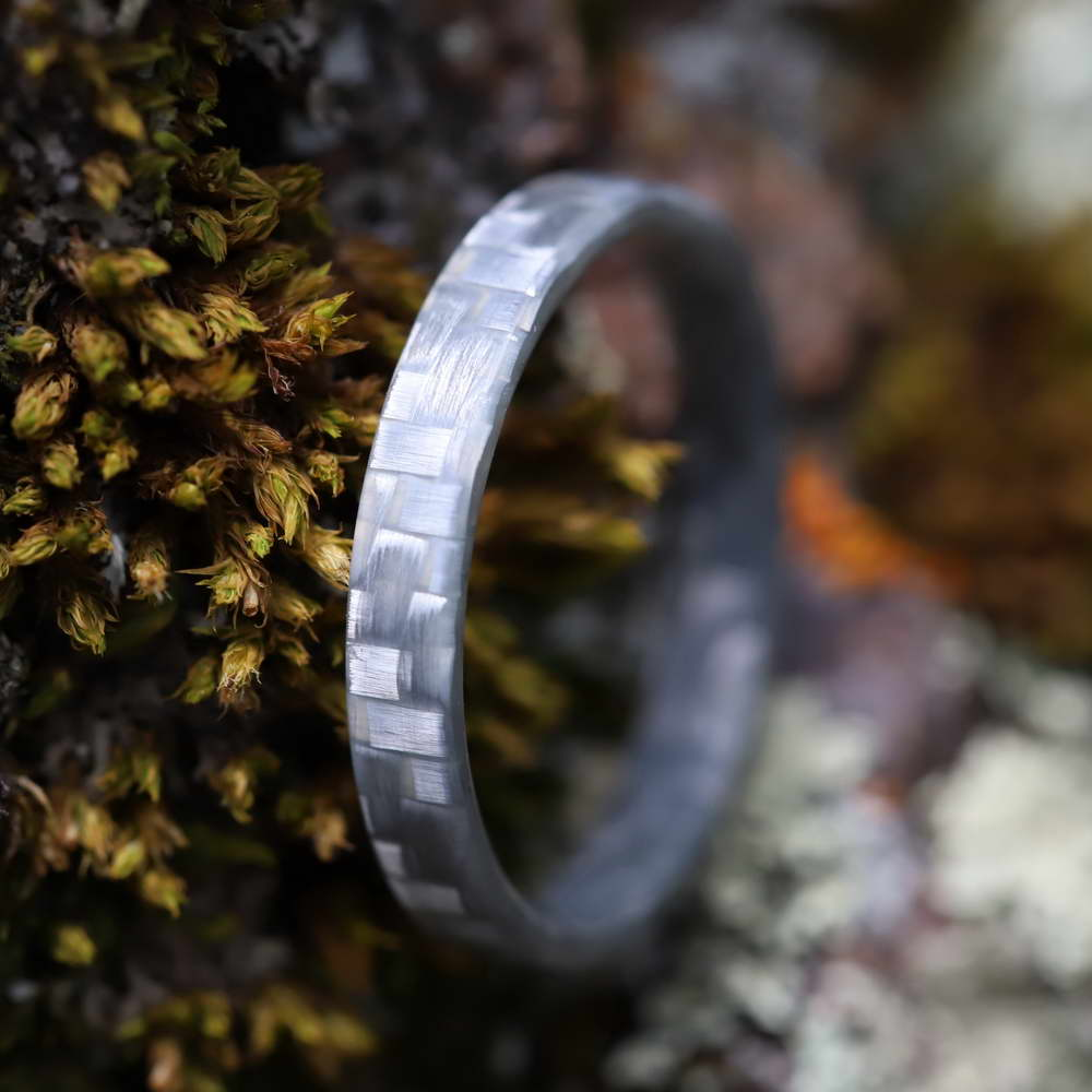 A stackable glass ring made of silver fiberglass