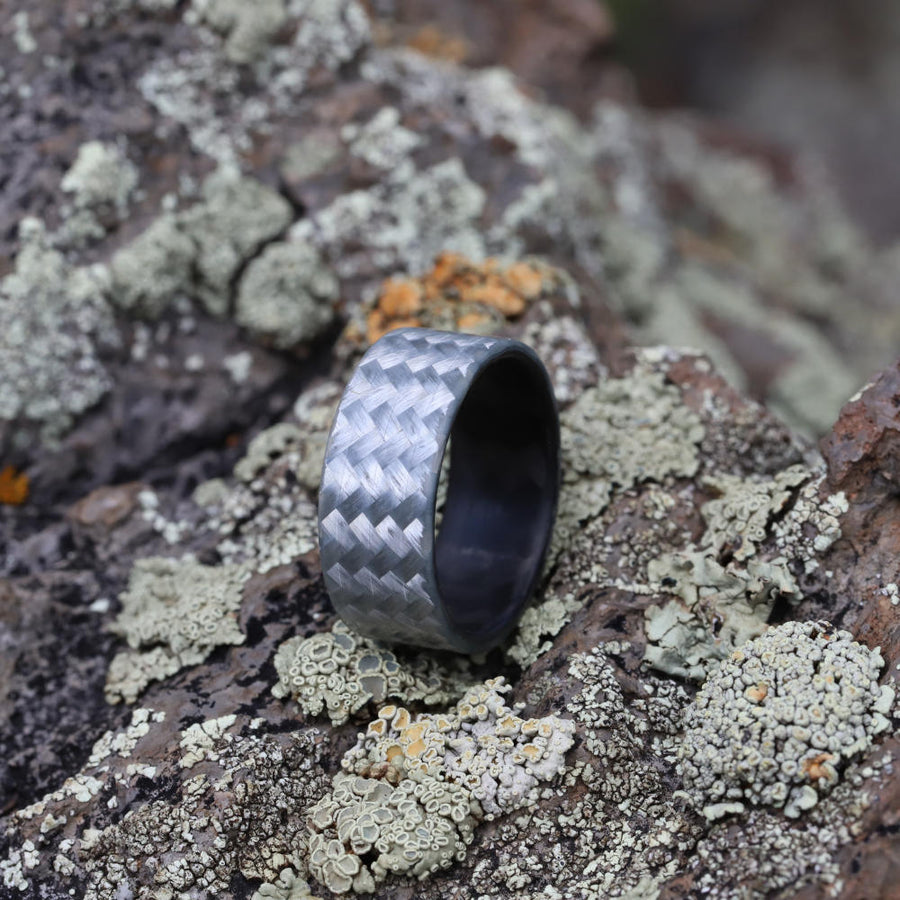 A silver men's carbon fiber wedding ring