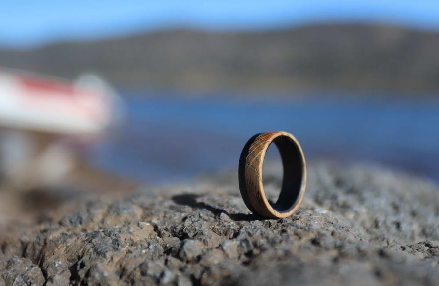 Whiskey Barrel Wood Ring outside on a rock