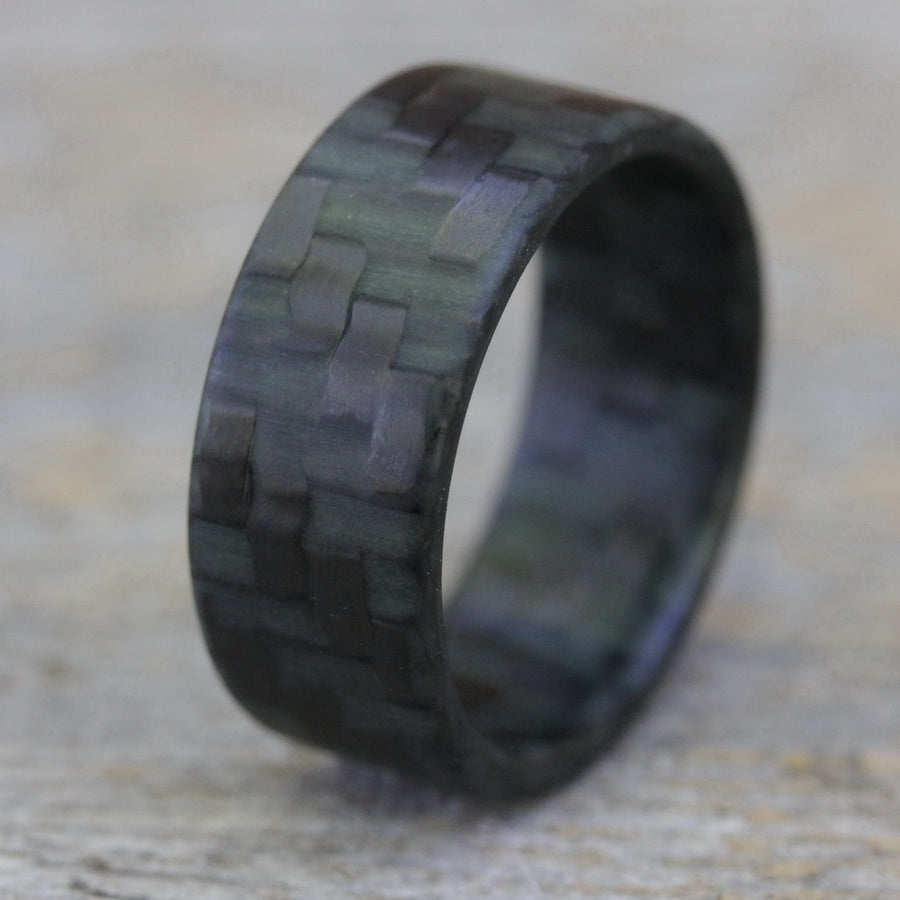 A woven carbon fiber glow ring