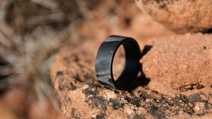 A filament carbon fiber ring on the red rocks of the desert