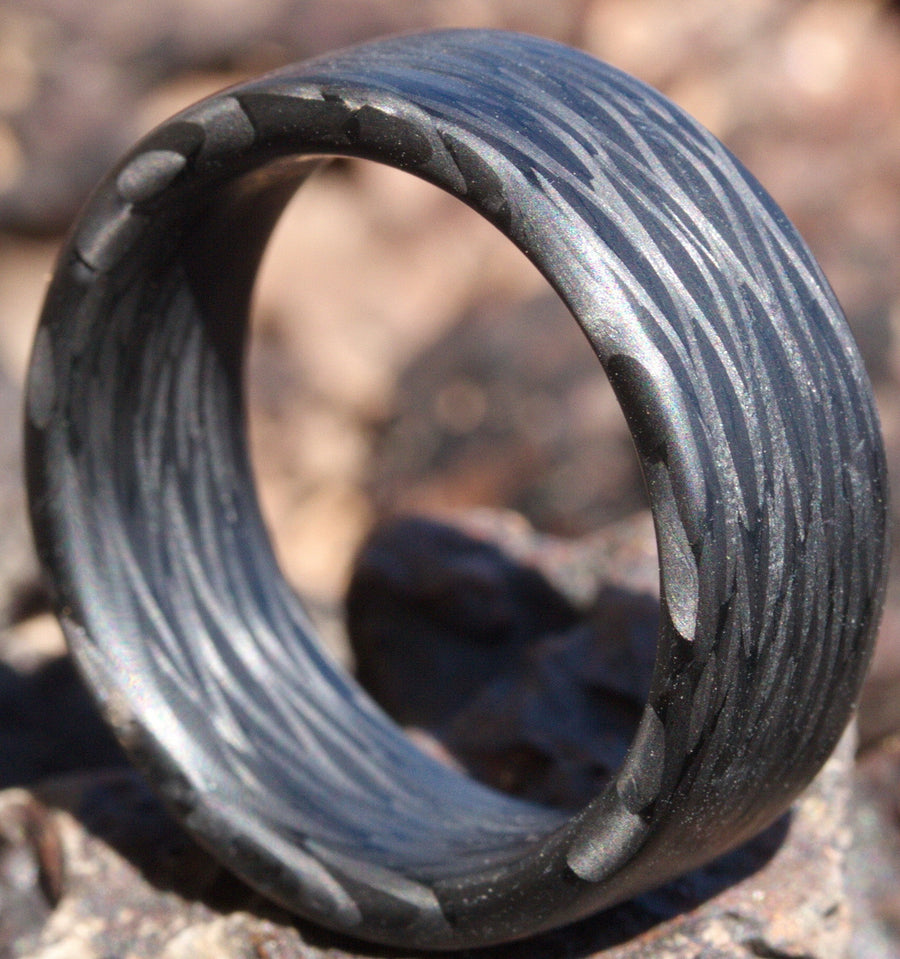 Our wave carbon fiber ring in the desert
