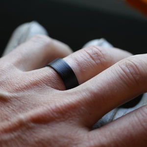 A man wearing his carbon fiber wedding ring