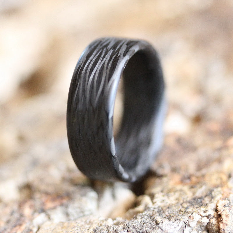 The wave carbon fiber ring in the dirt