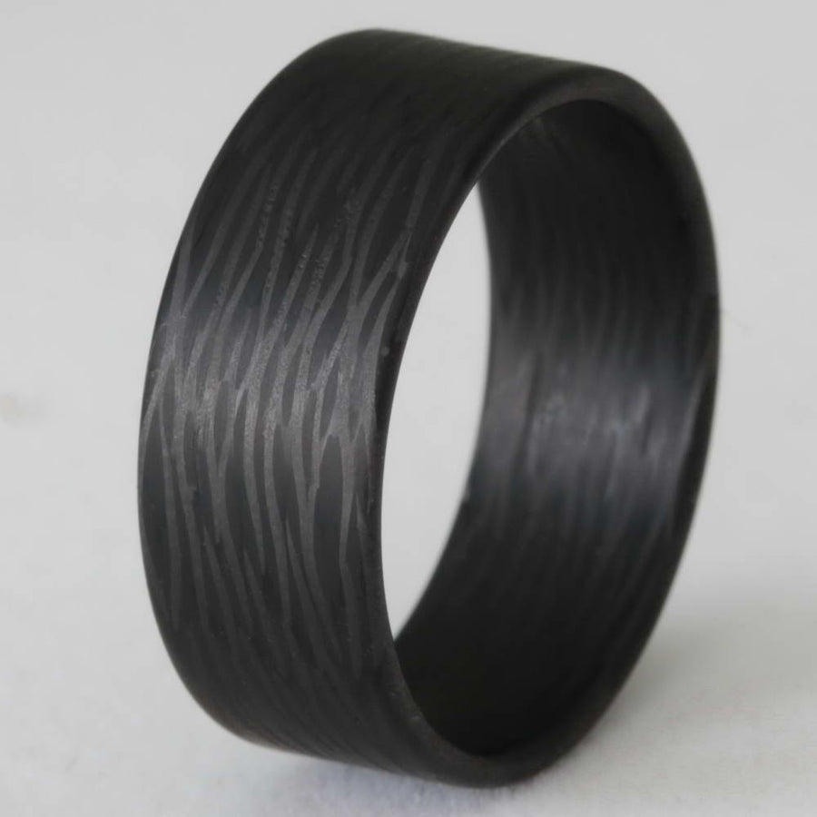 A men's carbon fiber wedding ring